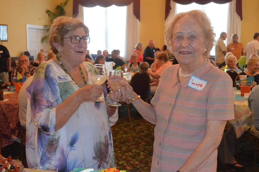 Historical Society President Pat Sample makes a toast with Lupe Burt who founded the organization in 1976.  Photos by Wayne Grant