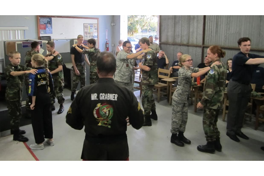 A group shot of cadets working together at self-defense seminar. Photo courtesy of Civil Air Patrol