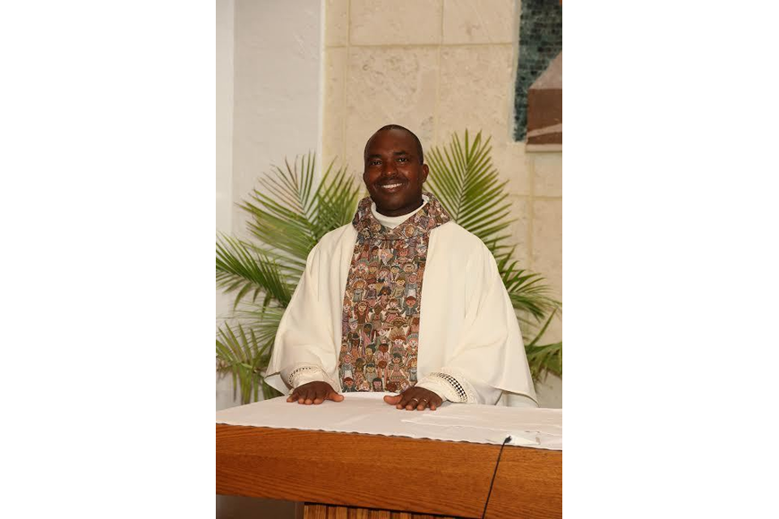 "Father Stephen Ogonwa ""Fr. Seno"" has been transferred from Prince of Peace Catholic Church. Courtesy photo"