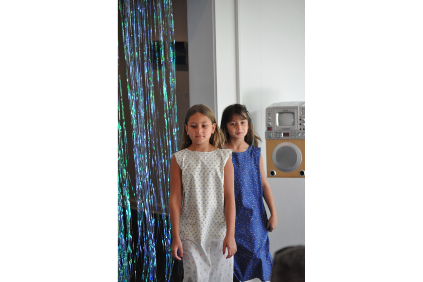 Madelyn, 7, and Mia Hate, 8, during the Fashionista Camp fashion show on June 30, at the Ormond Memorial Art Museum.