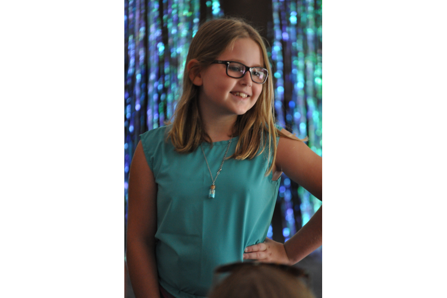 Summer Jackson, 9, during the Fashionista Camp fashion show on June 30, at the Ormond Memorial Art Museum.