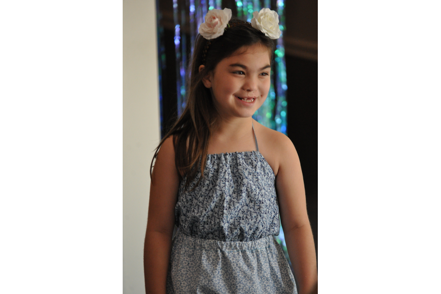 Isla Rose, 8, during the Fashionista Camp fashion show on June 30, at the Ormond Memorial Art Museum.