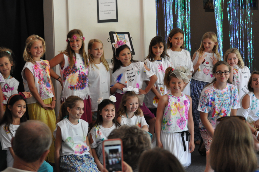 The Fashionistas pose for a post-fashion show group shot on June 30, at the Ormond Memorial Art Museum.