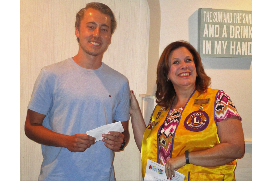 Scholarship Committee Chair Lion Linda Koch presents a scholarship check to Dalton Dalecki. Courtesy photo