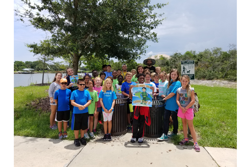 Amanda Kinzey (second row, second from left, with book) and a cleanup group at Waterfront Park in Palm Coast on June 26. Photo courtesy of Amanda Kinzey
