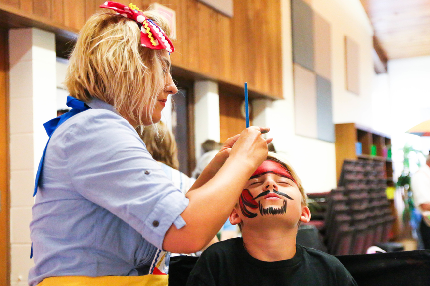 James Eddy gets his face painted like a pirate. Photo by Paige Wilson