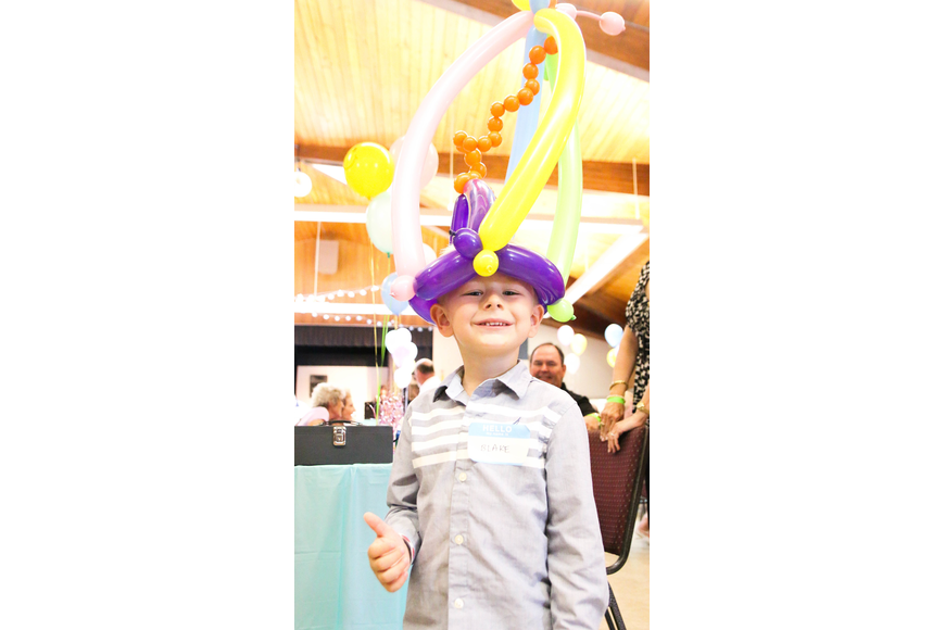 Blake Gray shows off his balloon hat. Photo by Paige Wilson