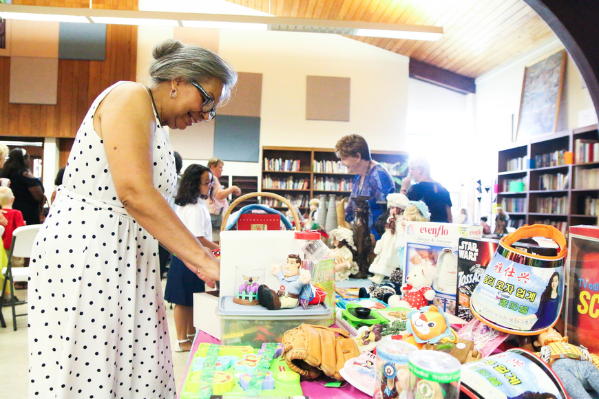 Anna Sanjurja peruses miscellaneous goods on sale to benefit Family Renew Community. Photo by Paige Wilson