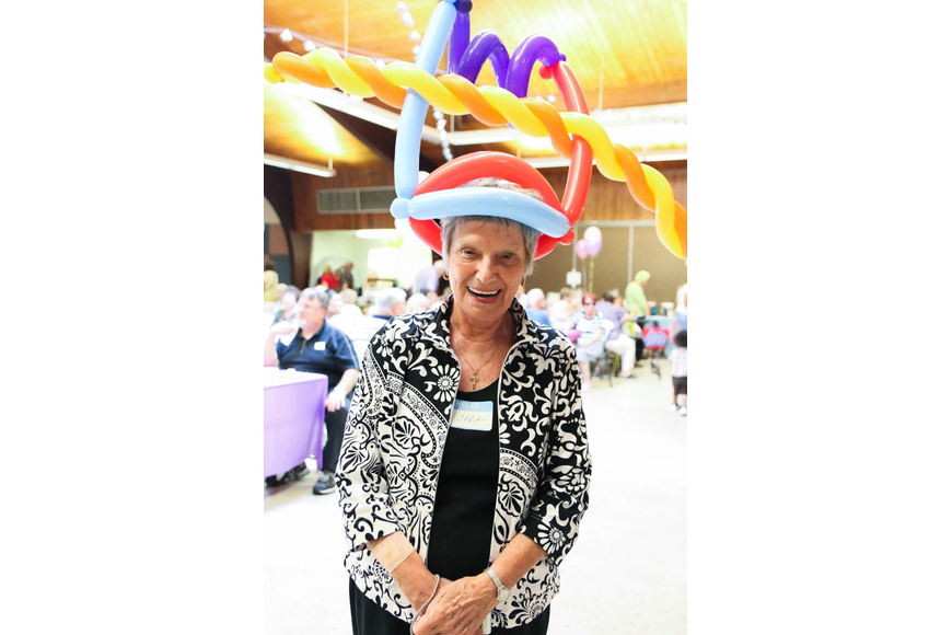 Cara O'Keefe wears a colorful balloon hat. Photo by Paige Wilson