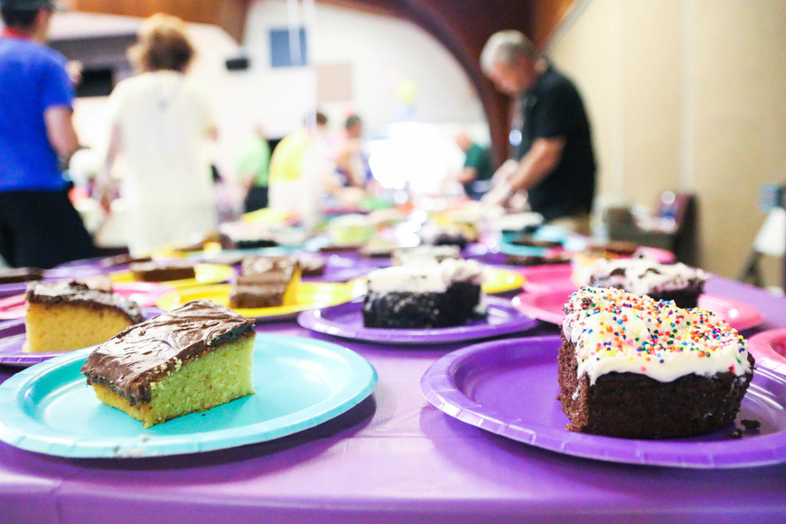 Different kinds of cakes sit on a table ready to be eaten. Photo by Paige Wilson