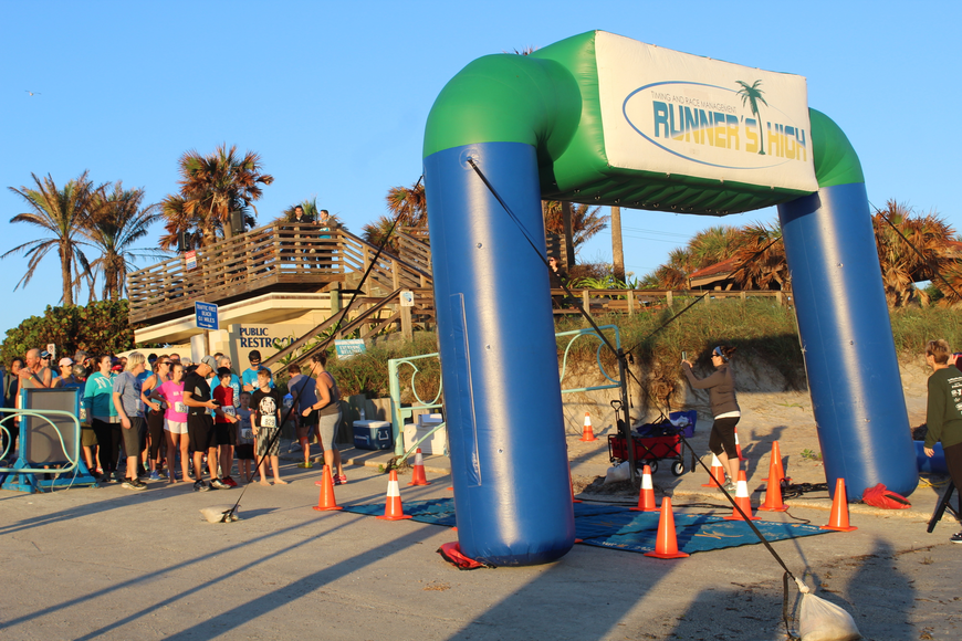 Runners get ready to take off at the Ormond Beach Family YMCA Polar Plunge 5K on Saturday, Dec. 2. Photo by Jarleene Almenas