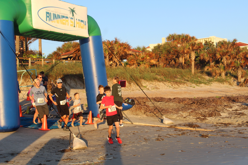 Asher Ravede leads the pack at the Ormond Beach Family YMCA Polar Plunge 5K on Saturday, Dec. 2. Photo by Jarleene Almenas