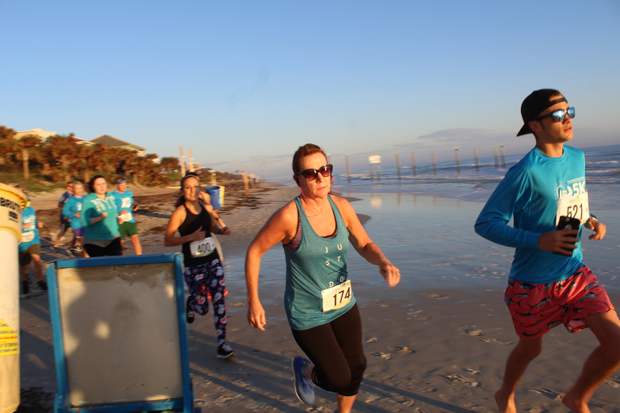 Runners take off at the Ormond Beach Family YMCA Polar Plunge 5K on Saturday, Dec. 2. Photo by Jarleene Almenas