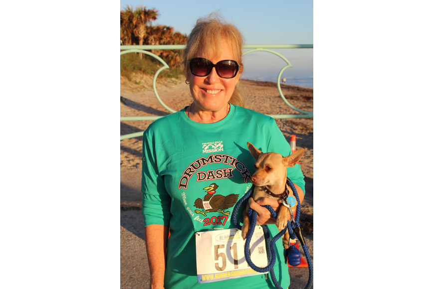 Debbie Omann and her dog Chico smile before joining the Ormond Beach Family YMCA Polar Plunge 5K on Saturday, Dec. 2. Photo by Jarleene Almenas