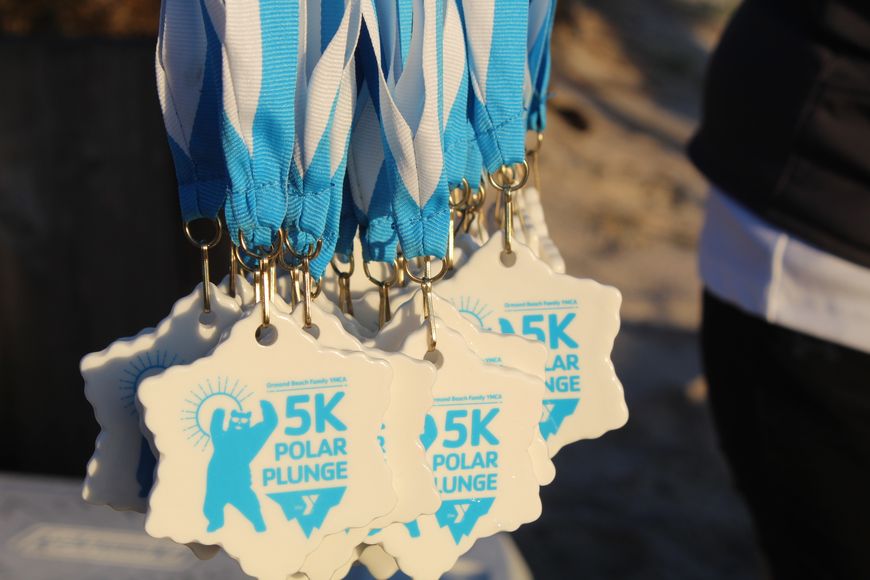 The medals presented to every person who completed the race were ceramic, that way they could be made into Christmas tree ornaments. Photo by Jarleene Almenas