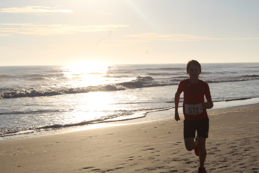 Asher Ravede arrives at the finish line before anyone else at the Ormond Beach Family YMCA Polar Plunge 5K on Saturday, Dec. 2. Photo by Jarleene Almenas