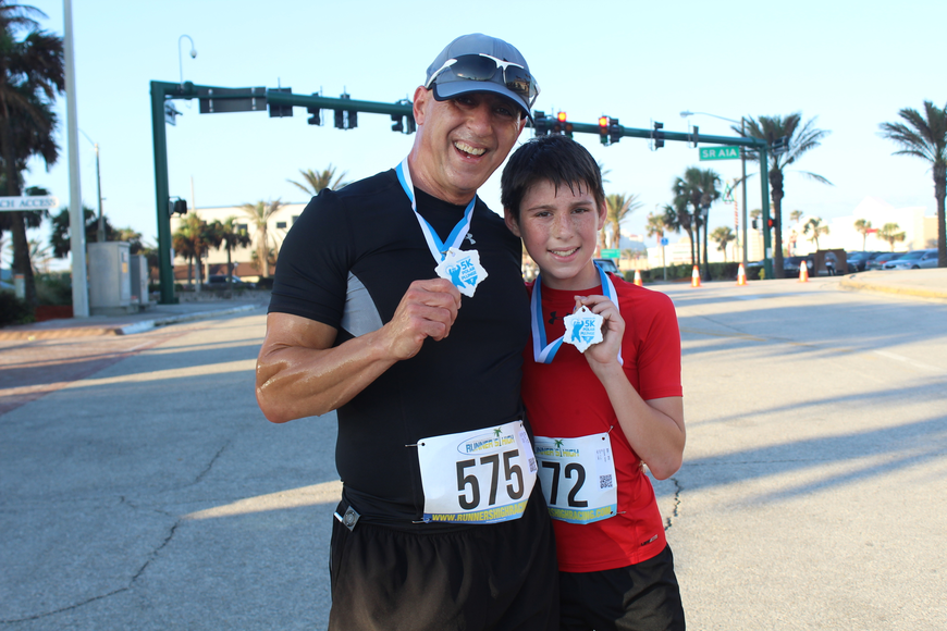 Jim and Asher Ravede won first and third place overall at the Ormond Beach Family YMCA Polar Plunge 5K on Saturday, Dec. 2. Photo by Jarleene Almenas