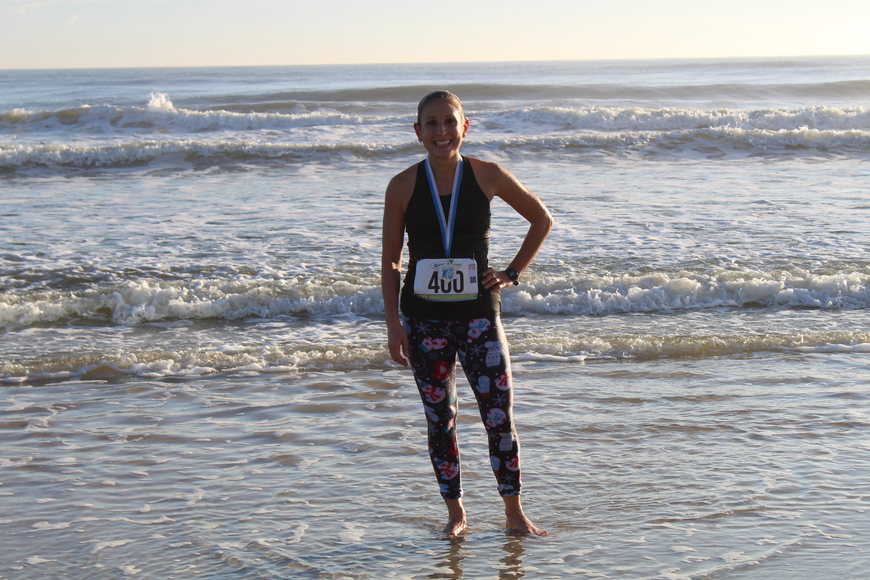 YMCA Volunteer Gina Kalis was the first person to jump into the water at the Ormond Beach Family YMCA Polar Plunge 5K on Saturday, Dec. 2. Photo by Jarleene Almenas