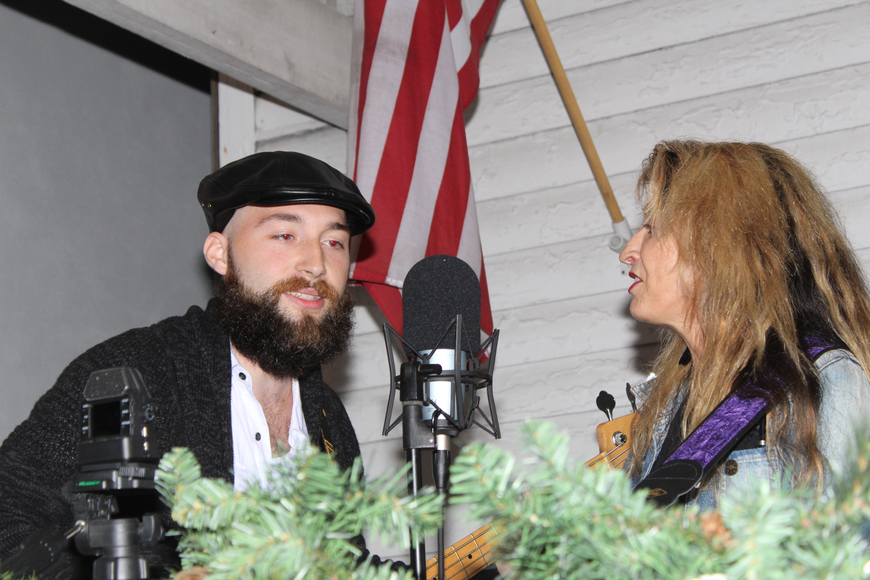 Wireless members Destin Elliott and Colleen Pearson sing outside the McDonald House during the 29th-annual
