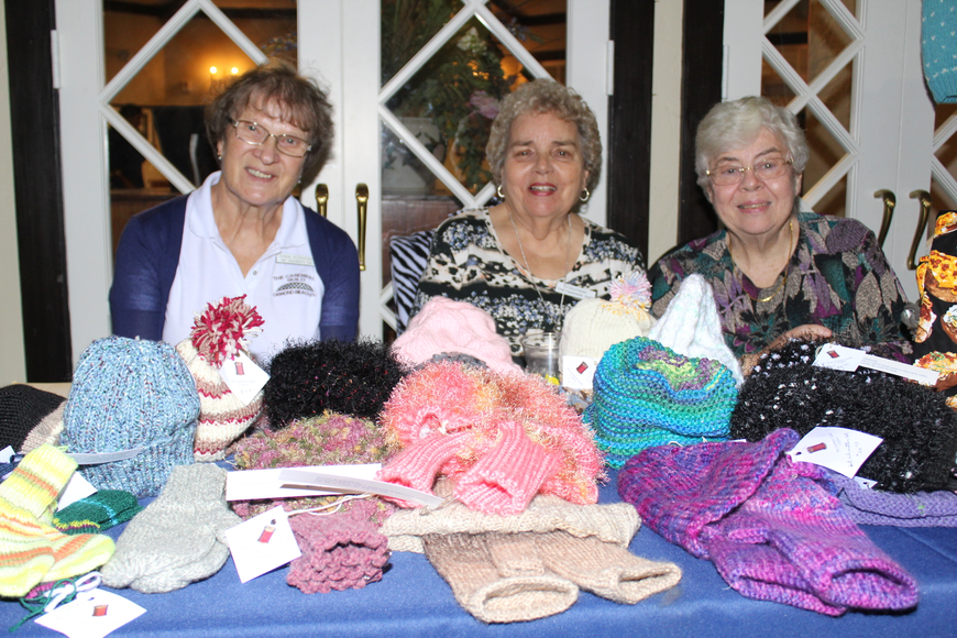 Anna Korhonen, Anne Bennett and Mary Ann Akam help sell some handmade knitted garments made by The Casements Crafters during the 29th-annual