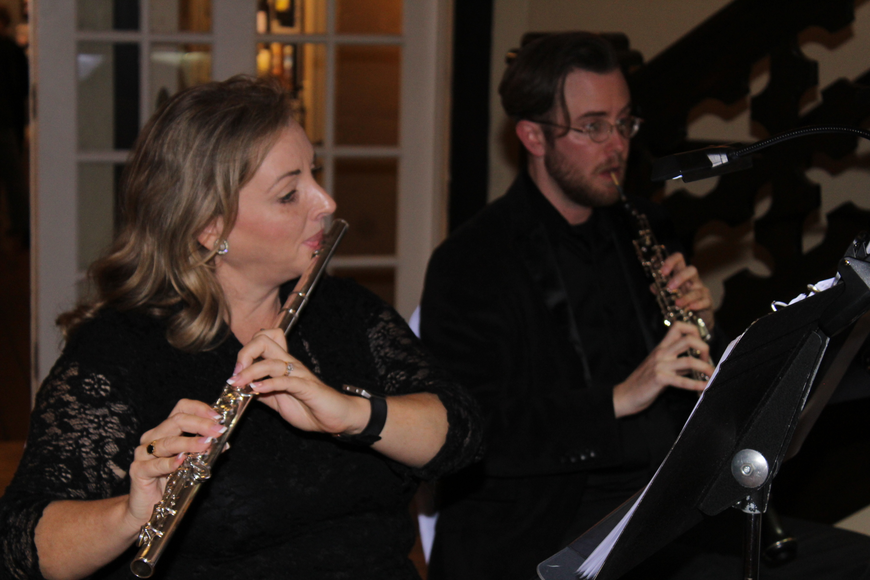 Jennifer Grey plays her flute as Jamie Kruger plays his oboe inside The Casements during the 29th-annual