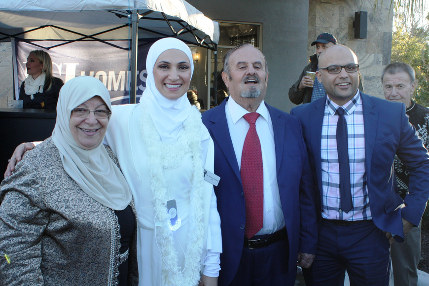 Dr. Huda Aljonaidy, second from left, has opened Blossom Dental. Photo by Wayne Grant