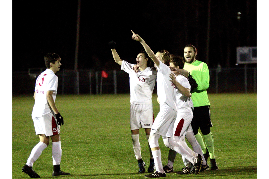 Seabreeze players celebrate after the Sandcrabs' district title win. Photo by Ray Boone