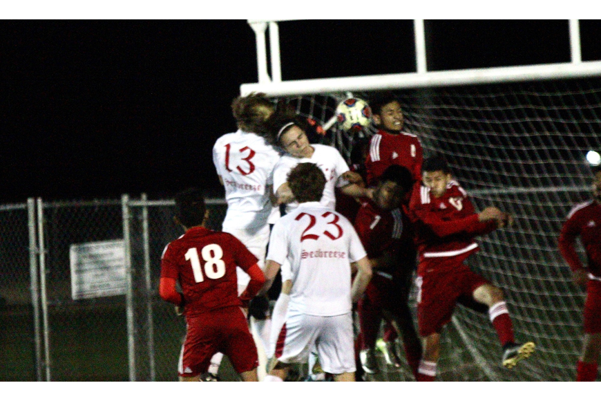 Seabreeze players leap in the air to head the ball. Photo by Ray Boone