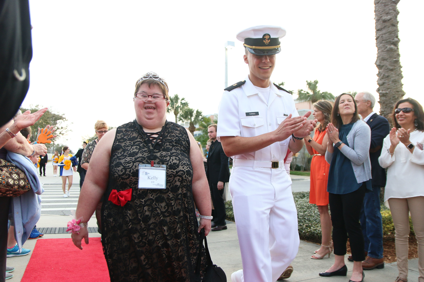 Kelly Jones, of Port Orange, get escorted by an Embry-Riddle Navy ROTC student. Photo by Paige Wilson