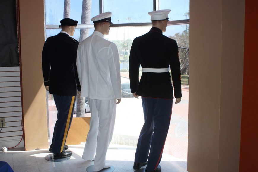 Manikins representing the Army, Navy and Marines  seem to look out the window of the Veterans Museum and Education Center on Beach Street. Photo by Wayne Grant