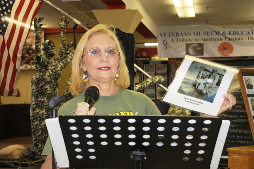 Donna Fresquez speaks about her dad, Thomas Brophy, who served in the Navy in World War II. Photo by Wayne Grant