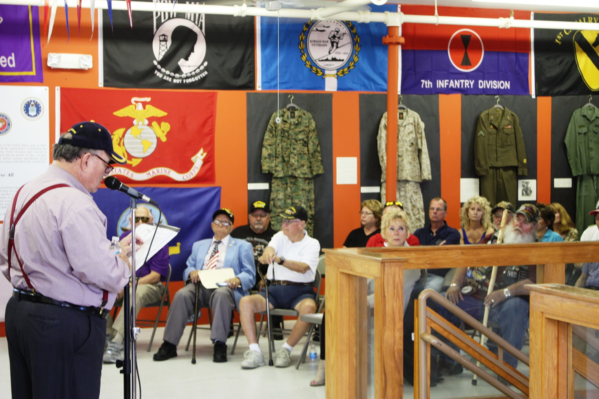 About 80 people attended a ceremony at the Veterans Museum and Education Center on Beach Street. Photo by Wayne Grant
