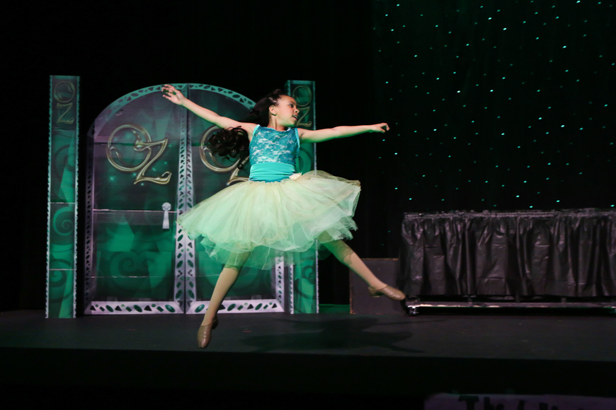 Aliyah Spar dances as the young Glinda just before her sister Sanah Spar takes her place. Photo by Paige Wilson