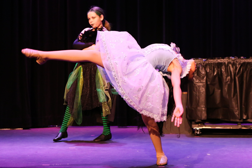 Aliyah Spar dances as the young Glinda while Anna York acts moody as the young Elphaba. Photo by Paige Wilson