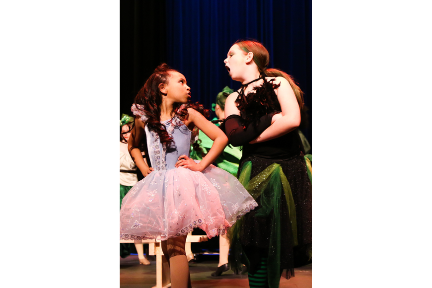 Aliyah Spar, as Glinda, and Anna York, as Elphaba, face off. Photo by Paige Wilson