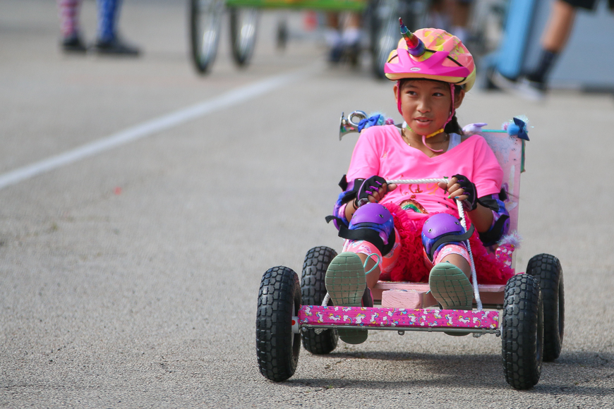 Magical unicorn team member Ylan Phan races in her colorful cart. Photo by Paige Wilson