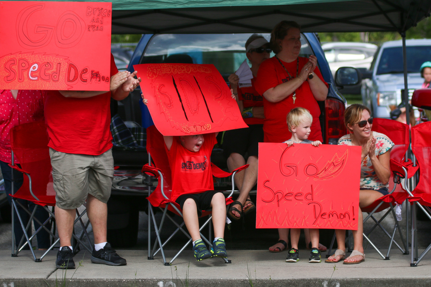 Family and friends of the Speed Demon team cheer on Kyan Cabiac and Bryce Singleton. Photo by Paige Wilson