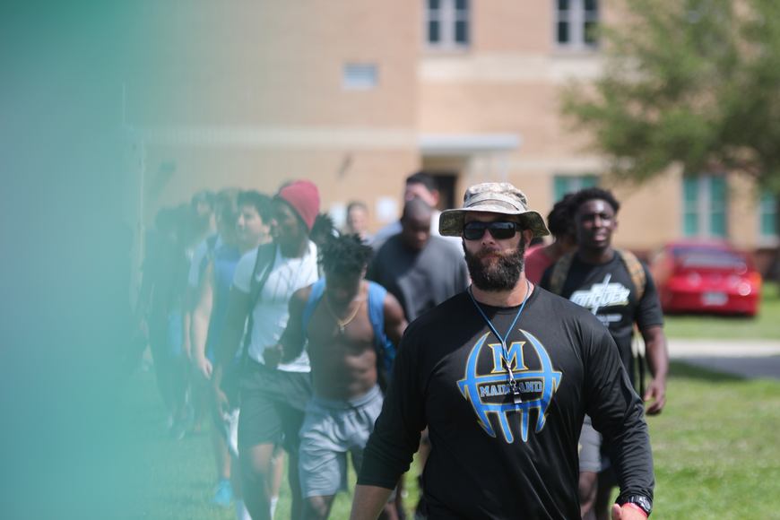 Strength and conditioning coordinator Danny Stein leads the Buccaneers onto the field. Photo by Ray Boone