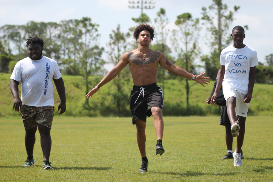 Mainland's K.J. Brathwaite (middle) stretches during workouts. Photo by Ray Boone