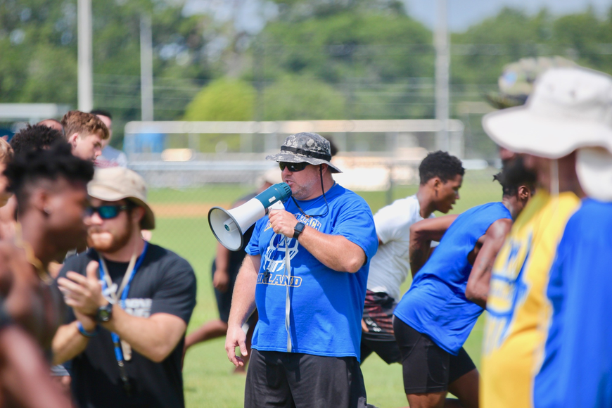Mainland coach Scott Wilson gives instructions to his team during the conditioning portion of workouts. Photo by Ray Boone