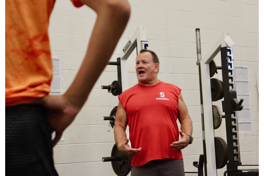 Seabreeze strength and conditioning coordinator Skip Saunier gives instructions to the team on how to lift. Photo by Ray Boone