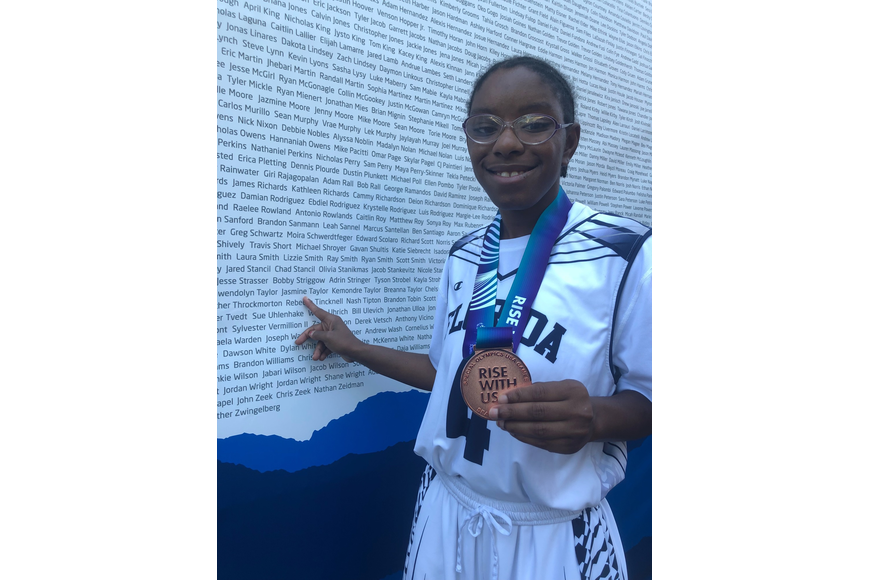 Athlete Jasmine Taylor poses with her bronze medal at the USA Games in Seattle. Courtesy photo