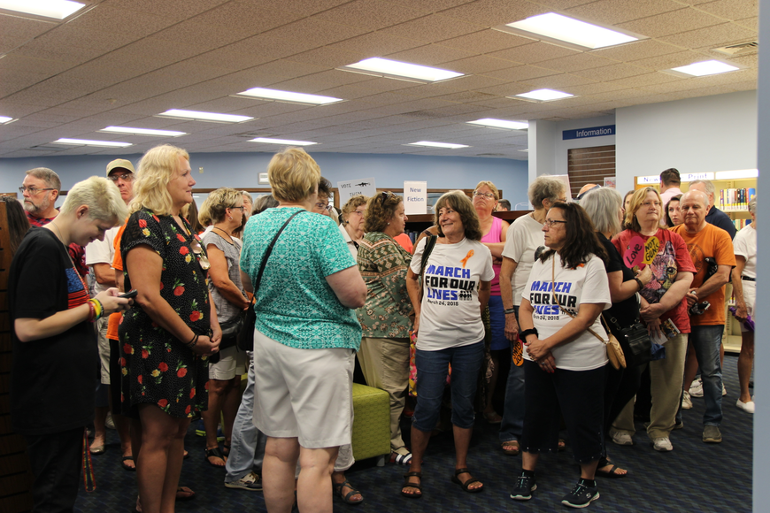 A crowd waits to go inside the auditorium at the Daytona Beach Regional City Island Library on July 15. Photo by Jarleene Almenas