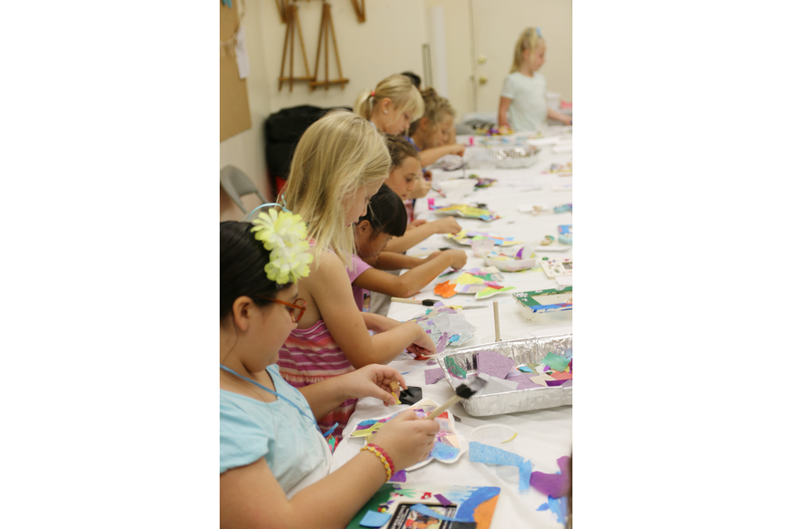 Girls work on their fish sculptures during OMAM's Bling Fling: Mermaid Camp on Tuesday, July 31. Photo by Jarleene Almenas