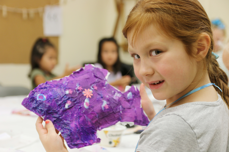 Zosia Russo shows off her purple fish sculpture during OMAM's Bling Fling: Mermaid Camp on Tuesday, July 31. Photo by Jarleene Almenas
