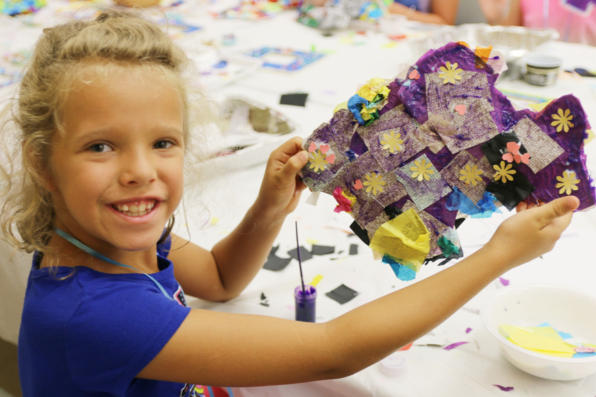 Brianna Morello shows off her fish sculpture during OMAM's Bling Fling: Mermaid Camp on Tuesday, July 31. Photo by Jarleene Almenas