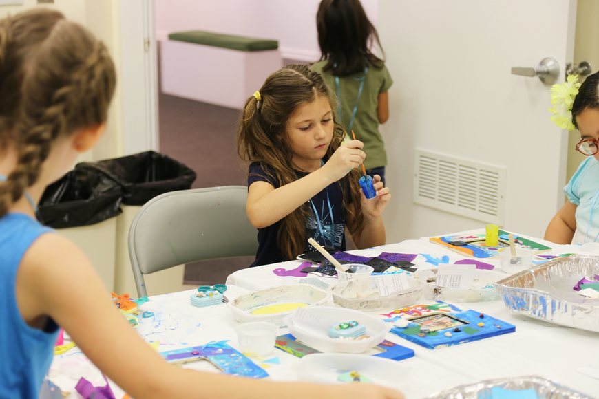 Christina Stafford adds some blue paint to her fish sculpture during OMAM's Bling Fling: Mermaid Camp on Tuesday, July 31. Photo by Jarleene Almenas