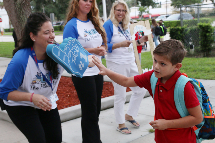 OBE Principal Shannon Hay high-fives Landon Peace on the first day of school at Ormond Beach Elementary on Monday, Aug. 13. Photo by Jarleene Almenas