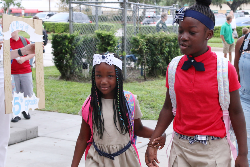 Natasha and Natalie Williams are welcomed on the first day of school at Ormond Beach Elementary on Monday, Aug. 13. Photo by Jarleene Almenas