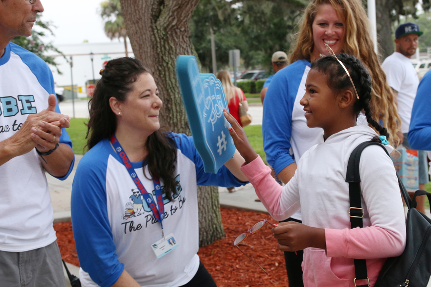 OBE Principal Shannon Hayes welcomes Nayelli Gailliard on the first day of school at Ormond Beach Elementary on Monday, Aug. 13. Photo by Jarleene Almenas